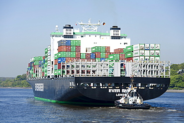 Container ship and tugboat, Port of Hamburg, Germany