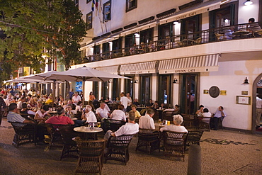 People sitting outside the Golden Gate Grand Cafe in the evening, Funchal, Madeira, Portugal