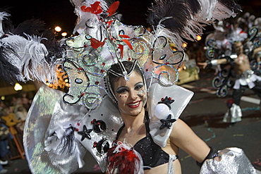 Woman in colourful costume at the Carnival Parade, Funchal, Madeira, Portugal
