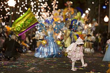 Young girl dancing at the Carnival Parade, Funchal, Madeira, Portugal