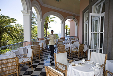 Waiter serves Afternoon Tea on the Terrace at Reid's Palace Hotel, Funchal, Madeira, Portugal