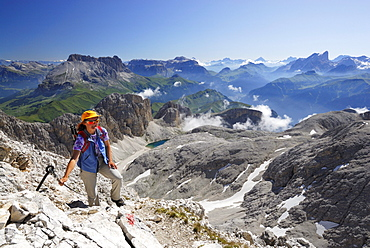 Woman ascending to mount Kesselkogel, Rosengarten group, Dolomites, Trentino-Alto Adige/South Tyrol, Italy