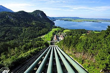 Down pipe of hydropower station lake Walchensee and pylons, lake Kochelsee in background, Bavarian Alps, Upper Bavaria, Bavaria, Germany