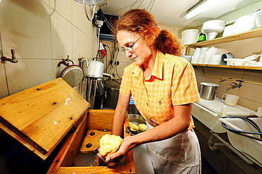 Woman taking butter from butter tab, Upper Bavaria, Bavaria, Germany