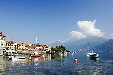 View over Lake Como to Menaggio with Bergamo Alps in background, Menaggio, Lombardy, Italy