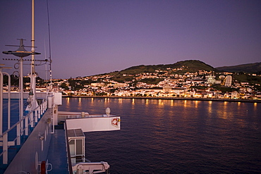 Cruiseship MS Delphin Voyager approaches Harbor at Dawn, Horta, Faial Island, Azores, Portugal, Europe