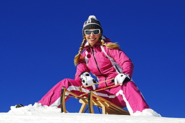 Sledging Woman, Bavaria, Germany, model released