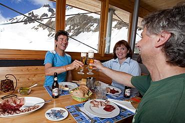 Three guests in mountain lodge Corno Gries, Val Bedretto, Canton of Ticino, Switzerland