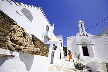 House with sculpture and church in the sunlight, Pirgos, island of Tinos, the Cyclades, Greece, Europe