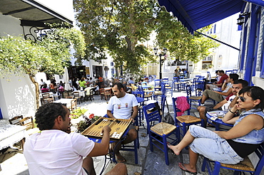 People sitting in front of a restaurant, Pirgos, island of Tinos, the Cyclades, Greece, Europe