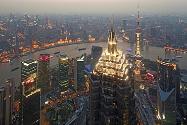 View at illuminated Jin Mao Tower, city and Huangpu river in the evening, Bund, Pudong, Shanghai, China, Asia