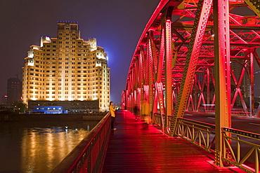 The illuminated Waibaidu bridge above the Souzhou canal at night, Bund, Shanghai, China, Asia