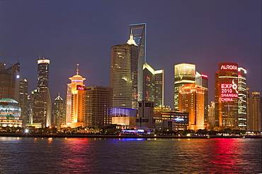 Illuminated skyline at Huangpu River at night, Pudong, Shanghai, China, Asia