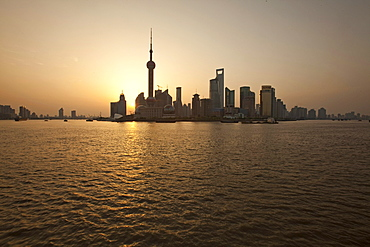 Skyline of Pudong at Huangpu river at sunrise, Pudong, Shanghai, China, Asia