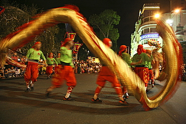 People at dragon dance during Tet festival at night, Saigon, Ho Chi Minh City, Vietnam, Asia