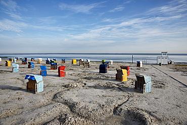 Roofed wicker beach chairs at beach, Carolinensiel-Harlesiel, East Frisia, Lower Saxony, Germany