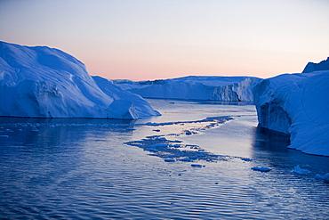 View at icebergs from Ilulissat Kangerlua Icefjord at dusk, Ilulissat (Jakobshavn), Disko Bay, Kitaa, Greenland