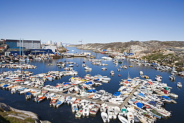 Fishing boats at harbour and Royal Greenland Seafood Processing Plant, Ilulissat (Jakobshavn), Disko Bay, Kitaa, Greenland