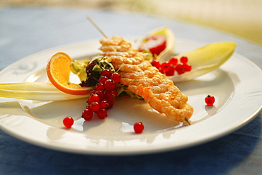 Prawn kebab, prawn skewer, served with chicory and red currants