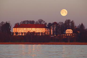 Rising moon over the old palace of Herrenchiemsee, Herreninsel, Lake Chiemsee, Chiemgau, Bavaria, Germany