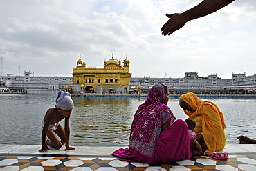 People in front of the Golden Temple, Sikh holy place, Amritsar, Punjab, India, Asia