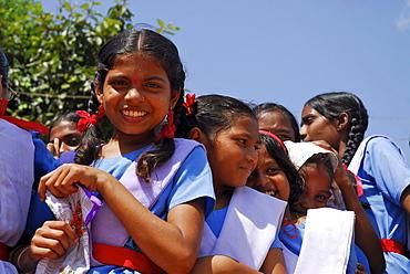 Girls wearing school uniforms in the sunlight, Bastar, Chhattisgarh, India, Asia