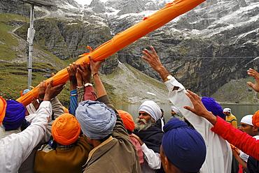 Sikh pilgrims at holy Hemkund lake, Garhwal Himalaya, Uttarakhand, India, Asia