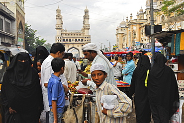 Muslim women wearing a chador at a streetmarket in front of Charminar, Hyderabad, Andhra Pradesh, India, Asia