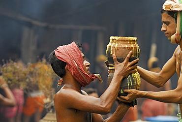 Young men carrying oblations, Ananta Vasudeva Temple, Bhubaneswar, Orissa, Asia