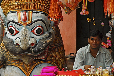 Trader selling oblations next to stone lion at Jagannath Temple, Puri, Orissa, India, Asia