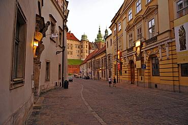Ulica Kanonicza at dusk, view towards Wawel, Krakow, Poland, Europe