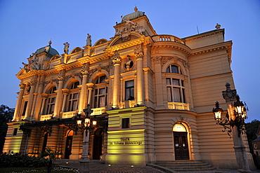 The theater Teatr Slowackiego at dusk, Krakow, Poland, Europe