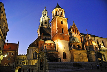 The illuminated Wawel cathedral in the evening, Krakow, Poland, Europe