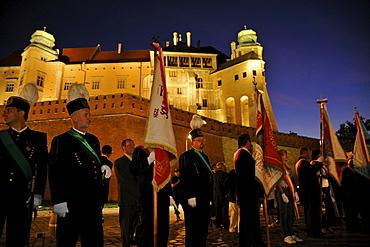 People at commemoration at Katyn Memorial below Wawel castle, Krakow, Poland, Europe
