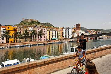 Italy Sardinia Bosa west coast canal, children on bicycle