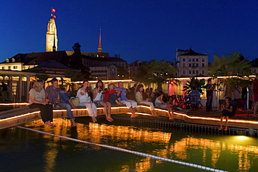 Switzerland Zurich, bare foot bar at river Limmat at night. background Grossmunster