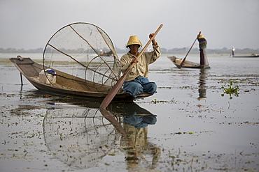 Intha fishermen on their fishing boats on Inle Lake, Shan State, Myanmar, Burma
