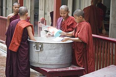 Buddhist monks getting their daily rice portion at Mahagandhayon monastary in Amarapura near Mandalay, Myanmar, Burma