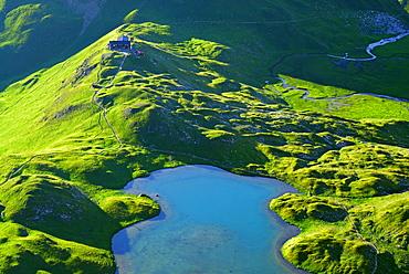 lake unterer Seewisee with hut Memminger Huette, Lechtal range, Tyrol, Austria