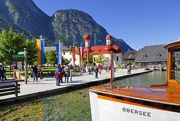 people walking on pier, with boat, St. Bartholomae, lake Koenigssee, Berchtesgaden range, National Park Berchtesgaden, Berchtesgaden, Upper Bavaria, Bavaria, Germany