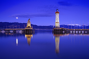 Lighthouse and sculpture of a lion at harbour in the evening, Lindau, Lake Constance, Baden Wurttemberg, Germany