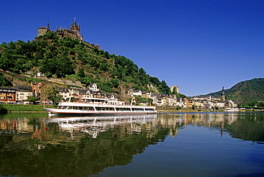 Reichsburg under blue sky and excursion boat on the river, Mosel, Rhineland-Palatinate, Germany