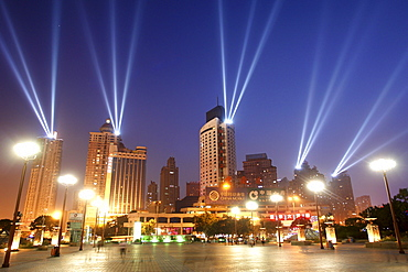 Festive floodlights on skyscrapers illuminate the sky at the port of Chongqing, China, Asia