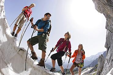 Hikers on cornice, Werdenfelser Land, Bavaria, Germany