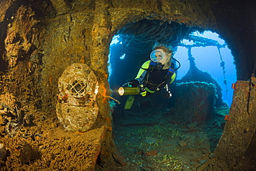 Diver discover Diving Helmet on Brigde of USS Saratoga, Marshall Islands, Bikini Atoll, Micronesia, Pacific Ocean