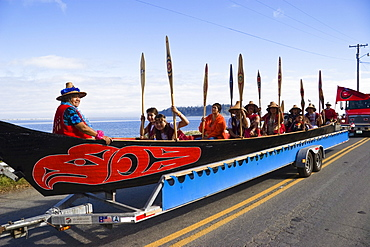 People in a canoe of Squamish Nation at Grand Parade, Makah Indian Reservation, Olympic Peninsula, Washington, USA