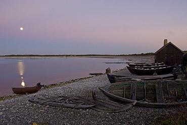 Wooden hut and boats on the beach, Faro, North coast, Gotland, Sweden, Scandinavia, Europe