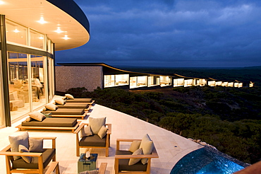 The illuminated terrace in front of the rooms of the Southern Ocean Lodge in the evening, Kangaroo Island, South Australia, Australia