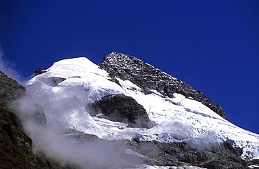 Glacier, snow covered mountain top under blue sky, Mount Aspiring National Park, South Island, New Zealand, Oceania