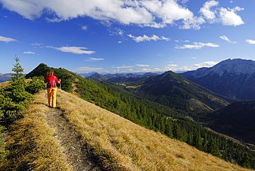Woman hiking at Schildenstein, Mangfall range, Bavaria, Germany